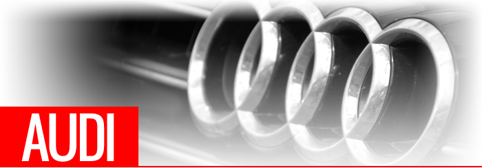 Audi text in front of car grill and badge